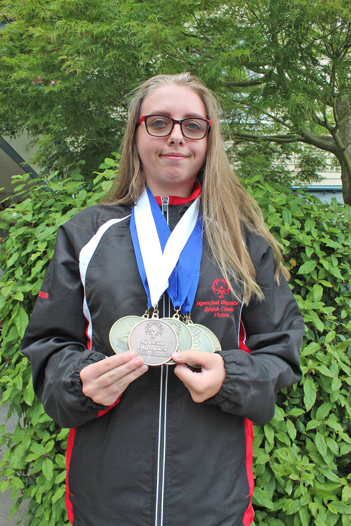 Eighteen-year-old Cheyenne Furlong-Goos shows off the four gold and bronze medals she won during the B.C. Special Olympic Summer Games in Kamloops earlier this month. Kendra Wong/Victoria News