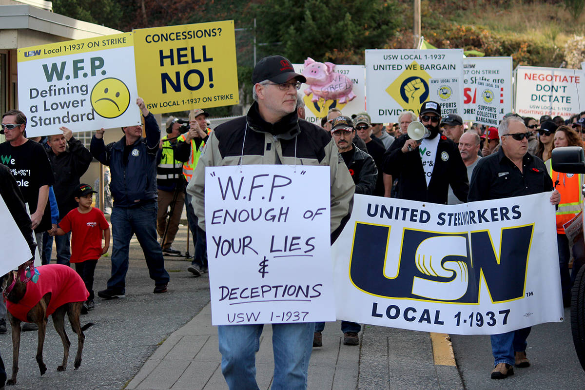 Pictured here, striking workers from a November rally in Nanaimo. (Black Press file)
